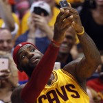 PICS: LeBron Takes A Break & Takes A Selfie With Fans During Preseason Game